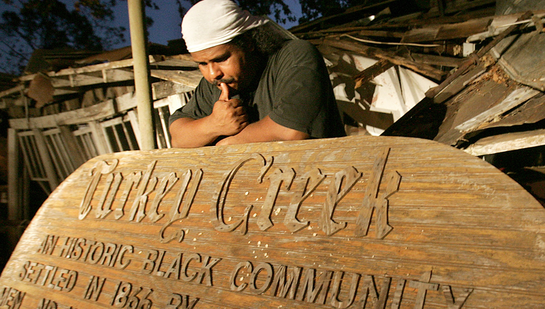 Derrick Evens with the Turkey Creek Historic Community Sign